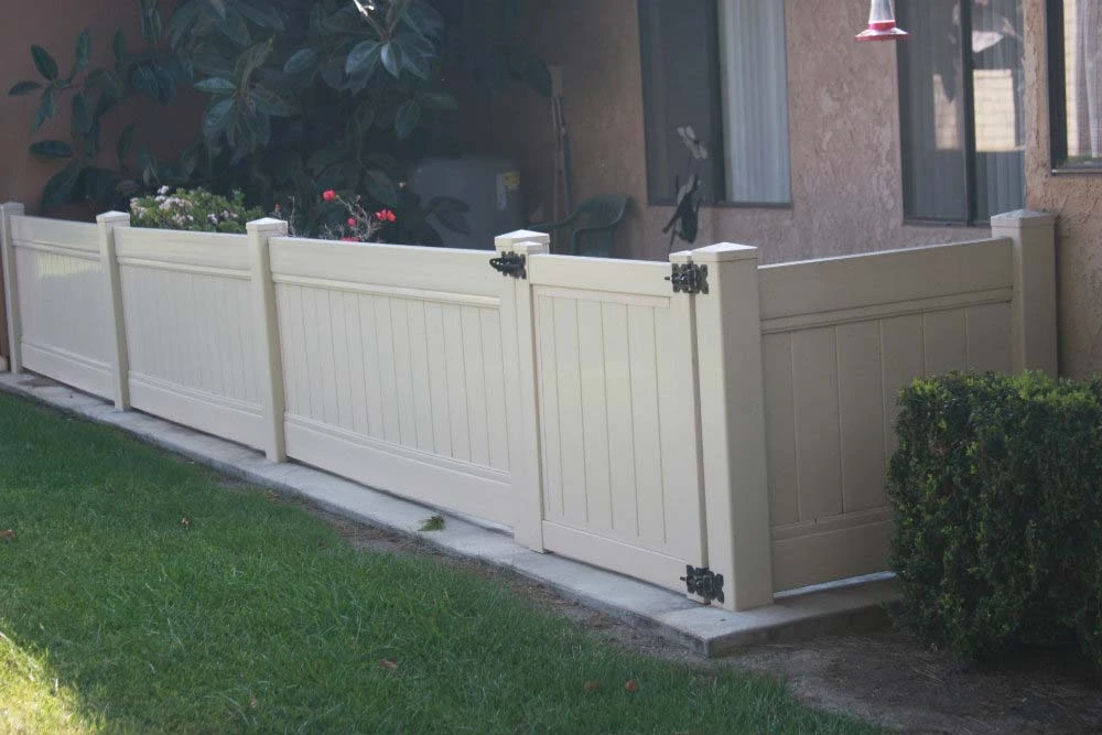 Tan Solid Vinyl Privacy Fencing with Gate